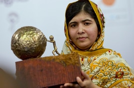 -FILE- In this Friday Sept. 6, 2013, file image, Pakistani teenager Malala Yousafzai, who was shot and injured by the Taliban…