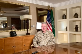 Marine Gen. Frank McKenzie, top U.S. commander for the Middle East, speaks to reporters traveling with him in Riyadh, Saudi…