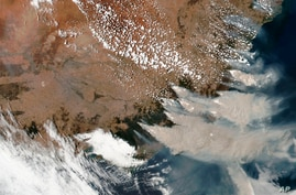 FILE - This satellite image provided by NASA on Saturday, Jan. 4, 2020 shows wildfires in Victoria and New South Wales,…