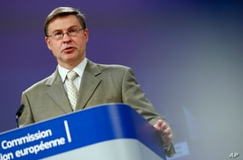 Executive Vice President of the European Commission Valdis Dombrovskis speaks during a media conference on the European…