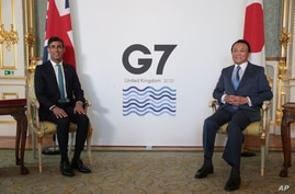 Britain's Chancellor of the Exchequer Rishi Sunak, left, meets with Japanese Deputy Prime Minister and Finance Minister Taro…