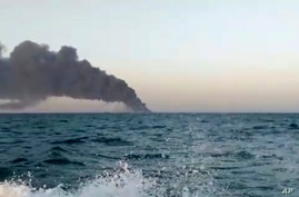 This image made from a video released on Wednesday, June 2, 2021 by Asriran.com, shows smoke rising from Iran's navy support…