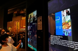 """A ticket screen showing a scene of the movie """"Far From Home"""", right, a short about the political division in Hong Kong…"""