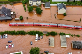 A regional train sits in the flood waters at the local station in Kordel, Germany, Thursday July 15, 2021 after it was flooded…
