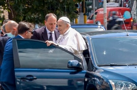 In this frame taken from video, Pope Francis stops to greet the police that escorted him before entering the Vatican after…