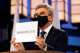 President of the International Olympic Committee Thomas Bach announces Brisbane as the 2032 Summer Olympics host city during…