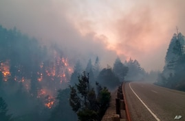 In this photo provided by the Oregon Department of Transportation flames from the Jack Fire burn along Oregon 138 near…