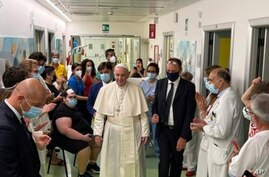 Pope Francis walks in the pediatric oncological ward of the Agostino Gemelli Polyclinic in Rome, Tuesday, July 13, 2021, where…