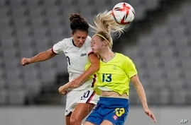 United States' Carli Lloyd, left, and Sweden's Amanda Ilestedt, right, go for a header during a women's soccer match at the…