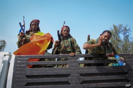 Tigrayan forces ride in a truck after taking control of Mekele, in the Tigray region of northern Ethiopia on Tuesday, June 29,…