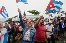 Demonstrators wave Cuban flags during a rally, Tuesday, July 13, 2021, in Miami. Demonstrators are protesting in solidarity…