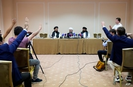 Members of political delegation from the Afghan Taliban's movement Dr, Mohammad Naim, left, Mawlawi Shahabuddin Dilawar, center…