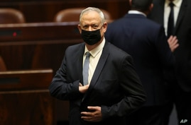 FILE - In this Sunday, June 13, 2021, file photo, Israeli politician Benny Gantz stands during a Knesset session in Jerusalem…