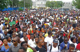 People march during a protest against corruption and economic failure in Monrovia