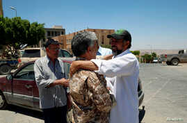 People celebrate the liberation of their city from the eastern forces led by Khalifa Haftar, in Gharyan.