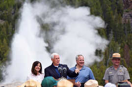 U.S. Vice President Mike Pence, with wife Karen, Interior Secretary David Bernhardt and Yellowstone National Park Superintendent Cam Sholly, speaks in front of Old Faithful Geyser in Yellowstone National Park in Wyoming, June 13, 2019.