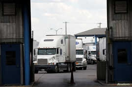 Trucks are seen after crossing the borderline from Mexico into the U.S. at the World Trade Bridge, in Laredo