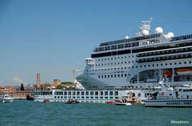 FILE PHOTO: The cruise ship MSC Opera loses control and crashes against a smaller tourist boat at the San Basilio dock in Venice.
