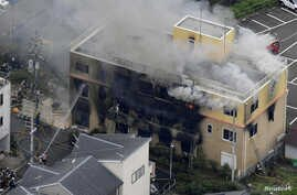 An aerial view shows firefighters battling fires at a three-story studio of Kyoto Animation Co. in Kyoto, western Japan,  July 18, 2019.