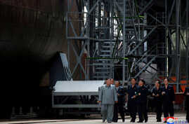 North Korean leader Kim Jong Un visits a submarine factory in an undisclosed location, North Korea