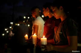 Mourners take part in a vigil at El Paso High School after a mass shooting at a Walmart store in El Paso, Texas, Aug. 3, 2019.