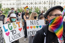 Members of a group supporting LGBT rights protest in Warsaw