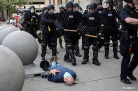 Martin Gugino lays on the ground after he was shoved by two Buffalo, New York, police officers during a protest against the death in Minneapolis police custody of George Floyd in Buffalo, New York