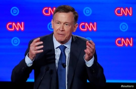 FILE PHOTO: Democratic 2020 U.S. presidential candidate former Colorado Governor John Hickenlooper speaks on the first night of the second 2020 Democratic U.S. presidential debate in Detroit