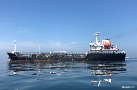 FILE PHOTO: An oil tanker is seen in the sea outside the Puerto La Cruz oil refinery in Puerto La Cruz