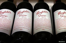 FILE PHOTO: Bottles of Penfolds Grange, made by Australian wine maker Penfolds and owned by Australia's Treasury Wine Estates, on a shelf for sale