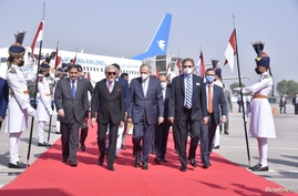 Abdul Razak Dawood, Advisor to the Prime Minister of Pakistan on Commerce and Investment walks with Head of the Afghanistan's peace council, Abdullah Abdullah, upon his arrival in Islamabad