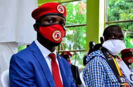FILE PHOTO: Ugandan musician turned politician, Robert Kyagulanyi also known as Bobi Wine and Uganda's four time Presidential candidate Kizza Besigye attend a joint news conference in Kampala