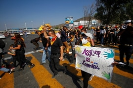 Migrants and human right activists protest against the U.S. and Mexico immigration policies and for the right to seek asylum, at the San Ysidro border crossing port in Tijuana