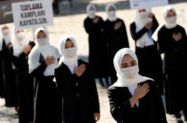 Ethnic Uighur women take part in a protest against China, in Istanbul