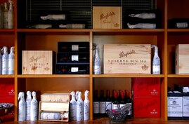 FILE PHOTO: Bottles of Penfolds Grange wine and other varieties, made by Australian wine maker Penfolds and owned by Australia's Treasury Wine Estates, sit on shelves for sale