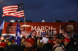 People take part in an event to show their support for U.S. President Donald Trump in Macomb County, Michigan