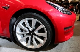 FILE PHOTO: A Tesla Model 3 electric vehicle is displayed at the Canadian International Auto Show in Toronto