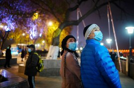 Duan Ling and her husband Fang Yushun walk on a street, almost a year after the global outbreak of the coronavirus disease (COVID-19) in Wuhan