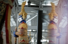 A Thai traditional giant statue wears a protective mask at Suvarnabhumi Airport in Bangkok