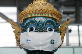 A Thai traditional giant statue wears a protective mask