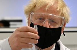 Britain's PM Johnson sees coronavirus vaccine manufacturing process in Wrexham