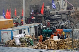 Rescuers work at the Hushan gold mine where workers were trapped underground after the Jauary 10 explosion, in Qixia