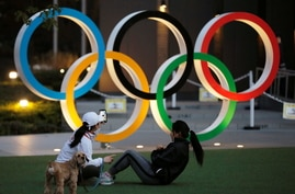 Olympic rings are seen near the National Stadium in Tokyo