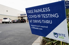 Vehicles line up at a self-swabbing coronavirus disease (COVID-19) test at a Rite Aid drive-thru during the outbreak of COVID-19, in Pasadena