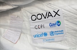 A pack of AstraZeneca/Oxford vaccines is seen as the country receives its first batch of coronavirus disease (COVID-19) vaccines under COVAX scheme, in Accra