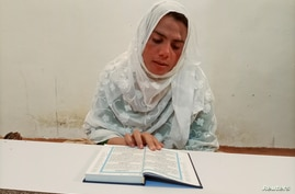 Rani Khan reads the Koran at Pakistan's first transgender only madrassah or a religious school, in Islamabad