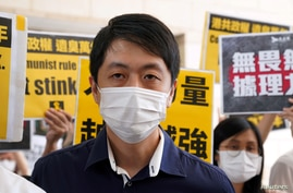 FILE PHOTO: Former pro-democracy lawmaker Ted Hui Chi-fung appears outside West Kowloon Magistrates' Courts in Hong Kong