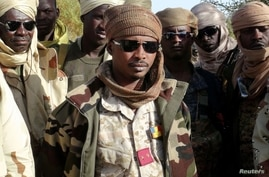 FILE PHOTO: Mahamat Idriss Deby Itno and Chadian army officers gather in the northeastern town of Kidal