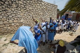 Believers pray for the release of kidnapped clergy members, in Port-au-Prince