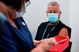 FILE PHOTO: The Pfizer COVID-19 vaccine is prepared for a high-risk worker in Melbourne